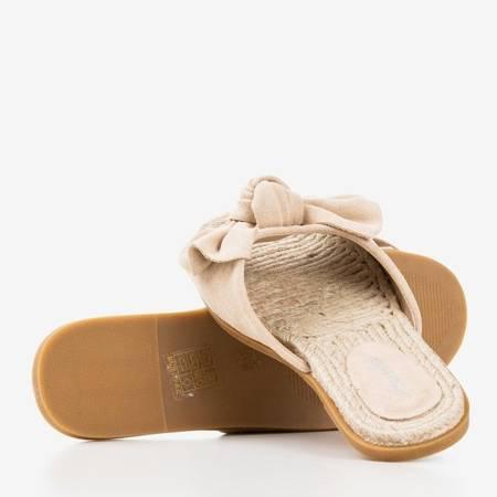 Бежеві жіночі шльопанці з бантом Revda - Взуття 1