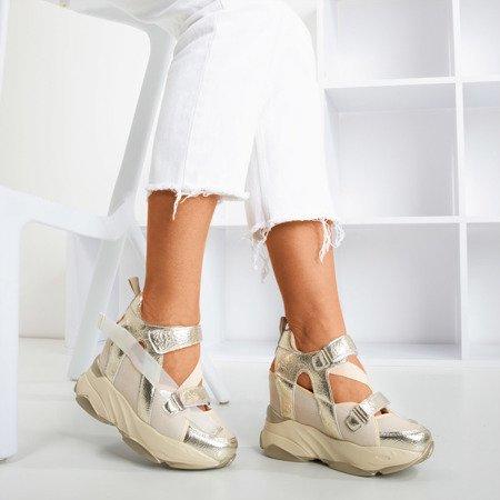 Золоті спортивні кросівки на закритому клині з вирізом Karix - Взуття 1